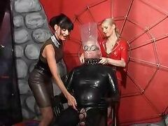 Two sexy and strict latex ladies torture mature man in rubber
