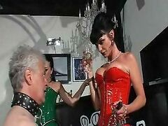 Two mature mistresses in latex and old male slaves